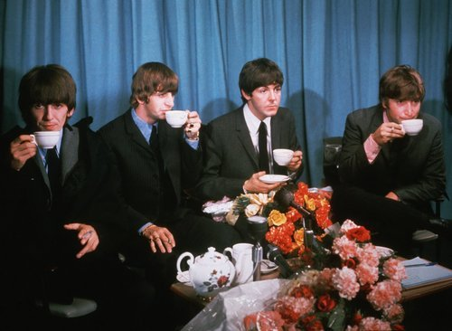 The Beatles enjoying some tea